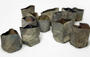 Furriols 'Dotze paperines en X' 2002 paper pigments pols marbre tosca cola 13,5x59x58,5cm